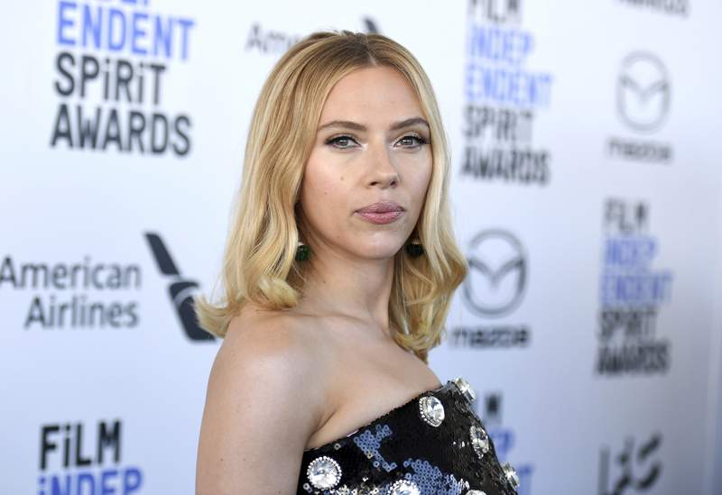 """FILE - Scarlett Johansson arrives at the 35th Film Independent Spirit Awards on Feb. 8, 2020, in Santa Monica, Calif. Johansson and the Walt Disney Co. announced Sept. 30, 2021, that they had settled a lawsuit the actor filed in July over the streaming release of """"Black Widow,"""" which she said breached her contract and deprived her of potential earnings. Terms were not disclosed, but the two sides released a joint statement in which they pledged to continue working together. (Photo by Richard Shotwell/Invision/AP, File)"""