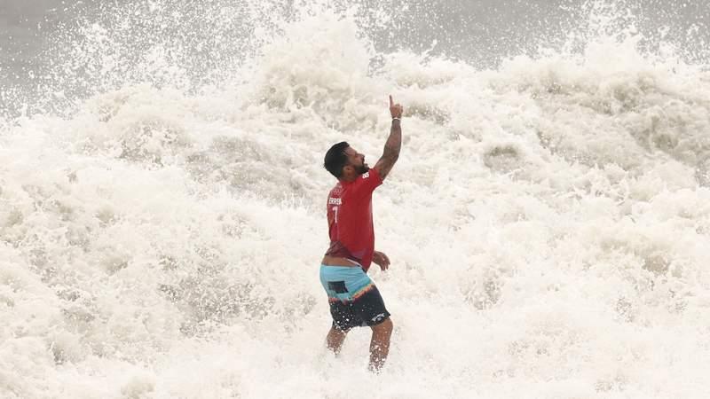 Italo Ferreira celebrates surfing victory
