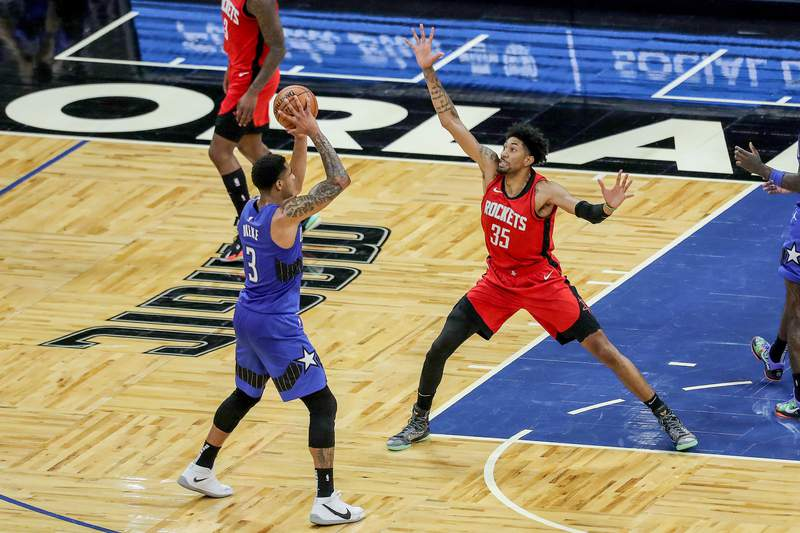 Christian Wood #35 of the Houston Rockets defends against Chuma Okeke #3 of the Orlando Magic during the second half at Amway Center on April 18, 2021 in Orlando, Florida.