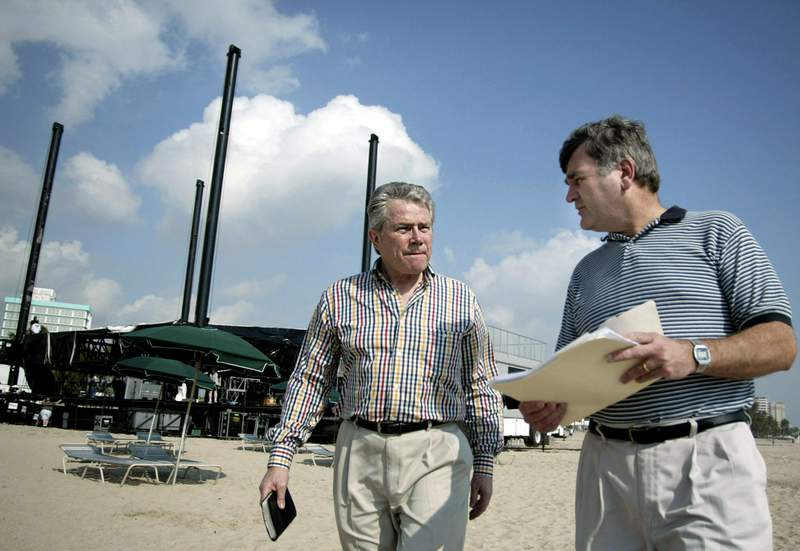 FILE - In this March 20, 2003 file photo Argentinian evangelist Luis Palau, left, discusses preparation's for BeachFest, his multi-media Christian revival, with assistant Fred Conklin as they stroll Fort Lauderdale Beach, in Fort Lauderdale, Fla. Palau, an evangelical pastor who was born in Argentina and went on to work as Billy Graham's Spanish interpreter before establishing his own international ministry, died Thursday, March 11, 2021, in Portland, Ore. He was 86. (AP Photo/Marianne Armshaw, File)