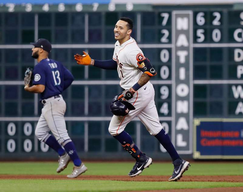 HOUSTON, TEXAS - SEPTEMBER 07: Carlos Correa #1 of the Houston Astros hits a walk-off double to beat the Seattle Mariners in the tenth inning at Minute Maid Park on September 07, 2021 in Houston, Texas. (Photo by Bob Levey/Getty Images)