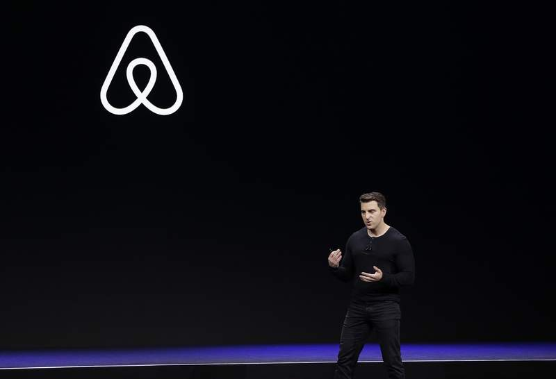 FILE - In this Feb. 22, 2018, file photo Airbnb co-founder and CEO Brian Chesky speaks during an event in San Francisco.  Airbnb will prohibit one-night rentals over Halloween weekend as part of its ongoing effort to crack down on party houses.  Airbnb says it will ban one-night rentals of entire homes in the U.S. and Canada on Oct. 30, 2020 or Oct. 31.  (AP Photo/Eric Risberg, File)