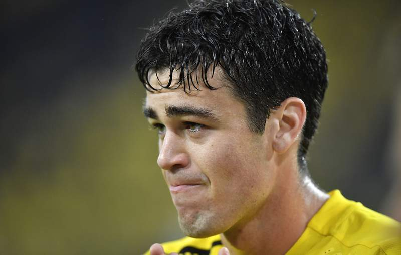 FILE - This Oct., 3, 2020, file photo shows Dortmund's Giovanni Reyna watching during the German Bundesliga soccer match between Borussia Dortmund and SC Freiburg in Dortmund, Germany. Gio Reyna, a son of former U.S. captain Claudio Reyna, got his first call-up to the U.S. national soccer team. The Borussia Dortmund midfielder is part of a 24-man roster for exhibitions at Wales on Nov. 12 and against Panama four days later in Austria. (AP Photo/Martin Meissner, File)