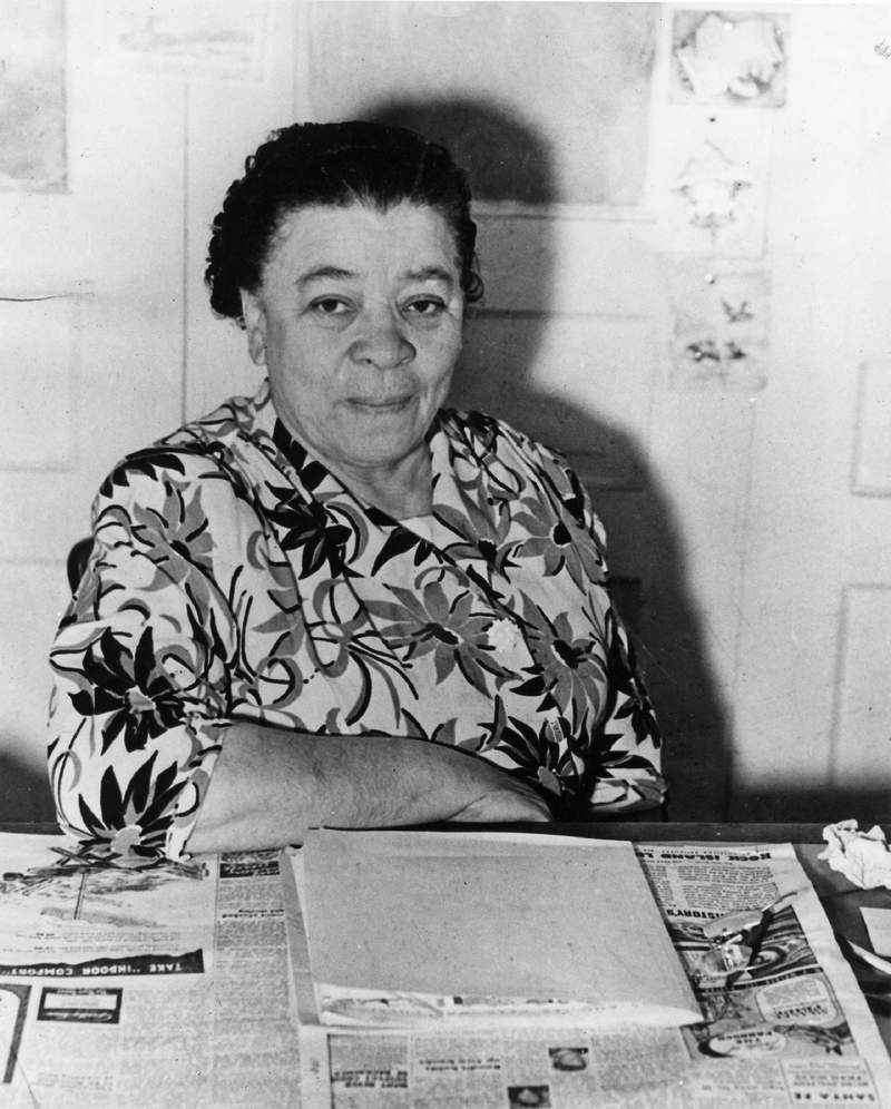 """In this 1952 photo, Charlotta Spears Bass, publisher of The California Eagle, a Black newspaper, sits in her Los Angeles office. The groundbreaking journalist and civil rights activist who ran in 1952 on the Progressive Party ticket is the subject of a new PBS/WNET """"American Masters"""" short. (Courtesy of Los Angeles Public Library via AP)"""