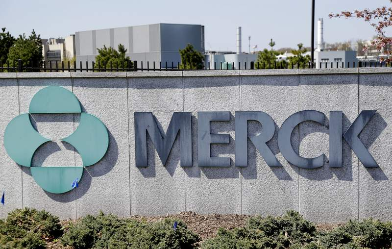 FILE- This May 1, 2018, file photo shows Merck corporate headquarters in Kenilworth, N.J.  Surging sales of cancer medicines and reduced spending helped Merck overcome a big hit from the coronavirus pandemic and increase its profit 12% in the second quarter. The  drugmaker on Friday, July 31, 2020,  increased its financial forecast for the year, all while its investing in development of two experimental vaccines and a possible treatment for COVID-19.  (AP Photo/Seth Wenig, File)