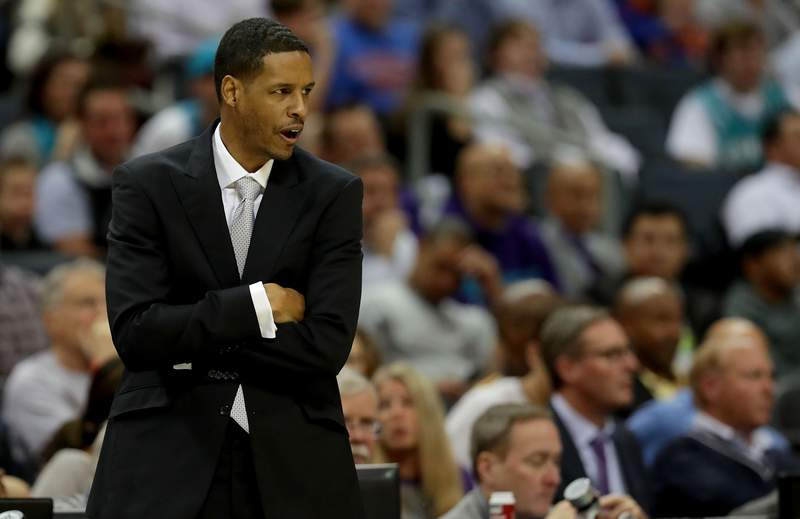 Associate head coach Stephen Silas watches on against the New York Knicks during their game at Spectrum Center on December 18, 2017 in Charlotte, North Carolina.  NOTE TO USER: User expressly acknowledges and agrees that, by downloading and or using this photograph, User is consenting to the terms and conditions of the Getty Images License Agreement.