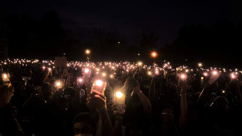 Protesters turn on their cell phone lights to honor the victims of police violence as they observe a minute of silence on June 19, 2020 in Richmond, Virginia. Juneteenth commemorates June 19, 1865, when a Union general read orders in Galveston, Texas stating all enslaved people in Texas were free according to federal law. (Photo by Eze Amos)
