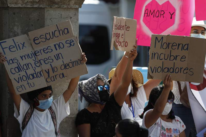 FILE - In this Feb. 24, 2021 file photo, women protest against ruling party politician Felix Salgado during a visit by Mexican President Andres Manuel Lopez Obrador and Argentina's President Alberto Fernandez in Iguala, Mexico. The elections agency withdrew the ballot registration for Salgado who was nominated to run for governor despite accusations of rape against him, the National Electoral Institute announced late Thursday, March 25, saying he failed to report the money he spent during the primary process. Mexico will hold state and federal mid-term elections on June 6. (AP Photo/Eduardo Verdugo, File)