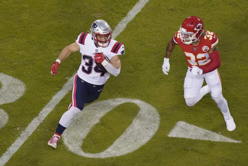 New England Patriots running back Rex Burkhead (34) runs from Kansas City Chiefs safety Tyrann Mathieu (32) during the first half of an NFL football game, Monday, Oct. 5, 2020, in Kansas City. (AP Photo/Charlie Riedel)