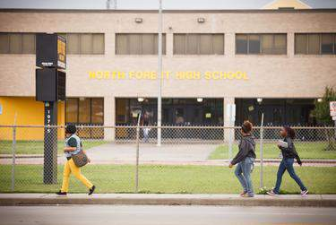 Students outside North Forest High School in Houston.      Michael Stravato for The Texas Tribune