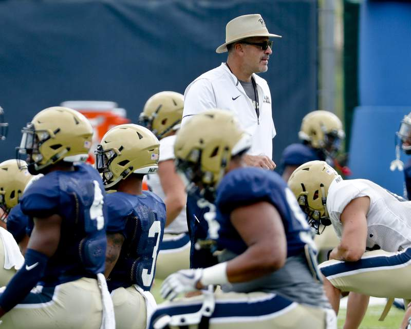 FILE - In this Aug. 9, 2018, file photo, Pittsburgh head coach Pat Narduzzi watches drills during an NCAA college football practice in Pittsburgh. Narduzzi shut down practice for a day last week when several players self-reported symptoms associated with COVID-19. All of them tested negative, but it provided an eye-opening insight into what coaching is like during a pandemic.(AP Photo/Keith Srakocic, File)