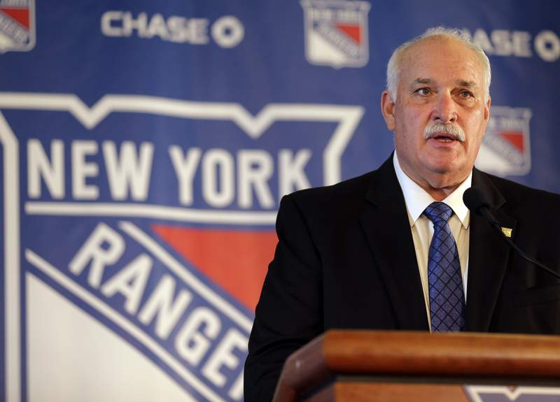 FILE - In this Wednesday, May 22, 2019, file photo, new New York Rangers team president John Davidson speaks during a news conference in New York. The Rangers might be on the clock in owning the No. 1 pick in the NHL draft on Tuesday, Oct. 6, 2020. That, and the prospect of selecting Quebec star forward Alexis Lafreniere, doesn't mean the still-retooling Rangers will be anywhere closer to being a contender, team president John Davidson cautions.(AP Photo/Seth Wenig, File)