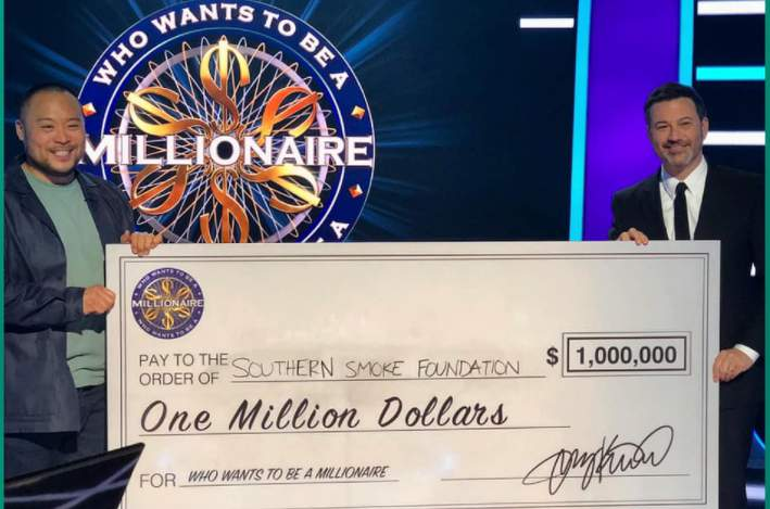 """Celebrity chef David Chang, pictured with """"Millionaire"""" host Jimmy Kimmel with a check totaling $1 million for Houston-based charity Southern Smoke."""
