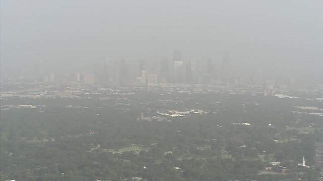 Dust from the Sahara Desert obscures the skyline of Houston on July 16, 2018.