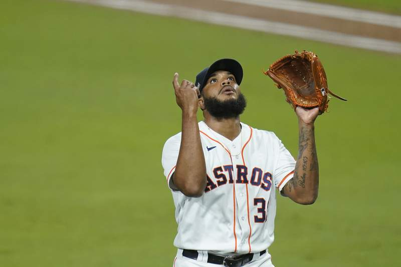 Houston Astros pitcher Josh James reacts after the third out in the seventh inning in Game 3 of a baseball American League Championship Series against the Tampa Bay Rays, Tuesday, Oct. 13, 2020, in San Diego. (AP Photo/Gregory Bull)