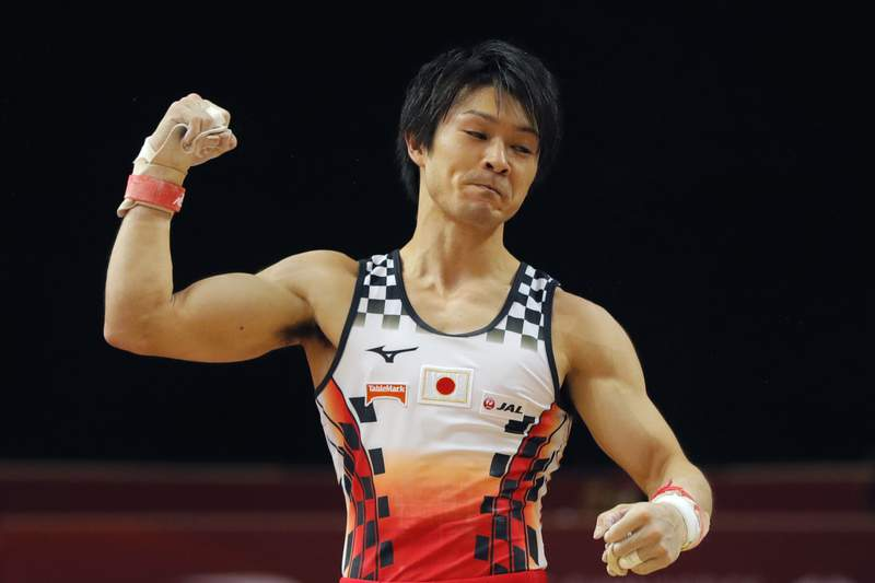 FILE - In this Oct. 29, 2018, file photo, Japan's Kohei Uchimura clenches his fist after his performance on the rings during the men's team final of the Gymnastics World Chamionships at the Aspire Dome in Doha, Qatar. Uchimura, who reported a positive COVID-19 test last week   and now testing negative several times, is expected to participate along with gymnasts from the United States, China, and Russia in a one-day meet on Sunday in Tokyo. (AP Photo/Vadim Ghirda, File)