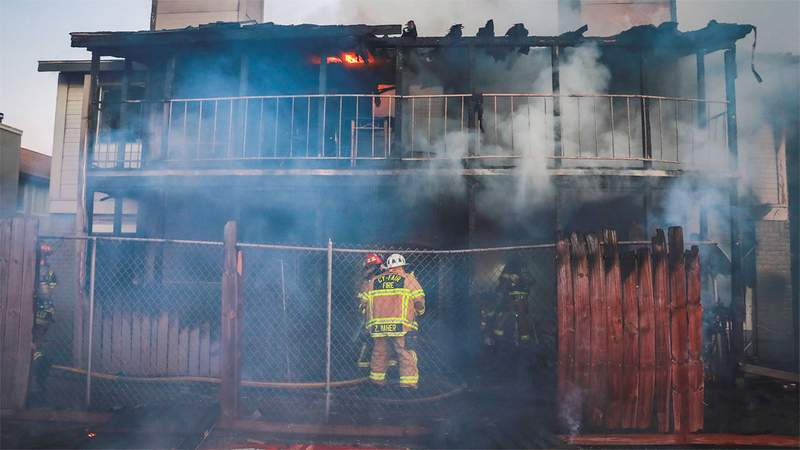 Smoke and flames are seen during an apartment building fire in Cypress, Texas, on Jan. 17, 2021.