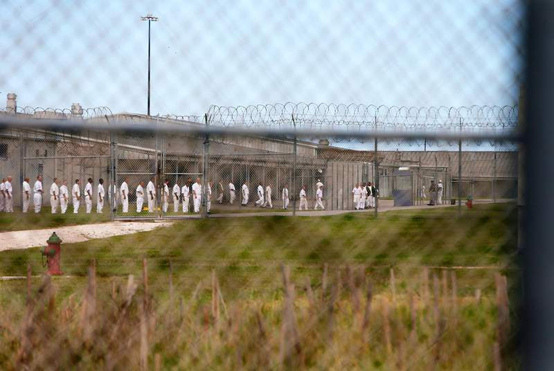 Prisoners line up inside the fences of the McConnell Unit in Beeville.                    Credit: Jennifer Whitney for The Texas Tribune