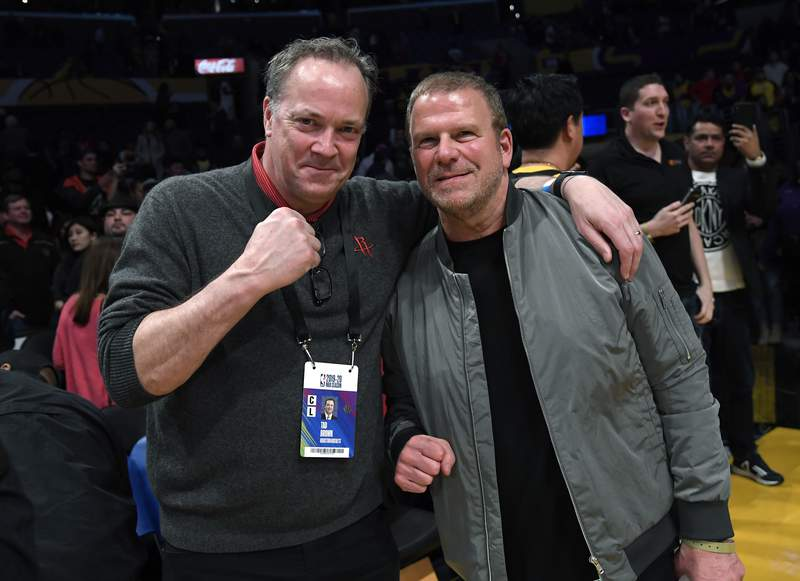 LOS ANGELES, CA - FEBRUARY 06: Tad Brown (L), Chief Executive Officer of the Houston Rockets, and Tilman Fertitta, owner of the Houston Rockets and chairman, Chief Executive Officer and sole owner of Landry's, Inc., one of the largest restaurant corporations, celebrate the Rockets win over Los Angeles Lakers at Staples  Center on February 6, 2020 in Los Angeles, California. NOTE TO USER: User expressly acknowledges and agrees that, by downloading and/or using this Photograph, user is consenting to the terms and conditions of the Getty Images License Agreement. (Photo by Kevork Djansezian/Getty Images)
