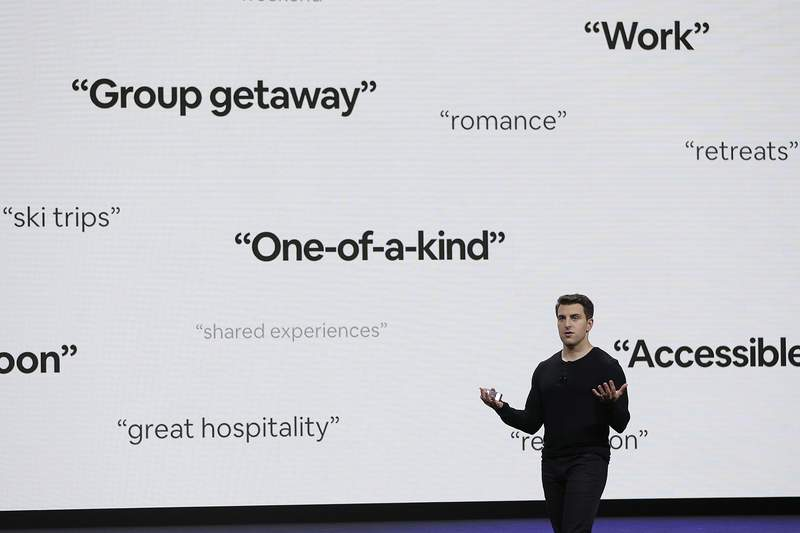 FILE - In this Feb. 22, 2018, file photo, Airbnb co-founder and CEO Brian Chesky speaks during an event in San Francisco. Thirteen years after its founders first rented air mattresses in their San Francisco apartment, Airbnb is making its long-awaited stock market debut. The home sharing company priced its shares at $68 apiece late Wednesday, Dec. 9, 2020 giving it an overall value of $47 billion. Starting Thursday, it will trade on the Nasdaq Stock Market under the symbol ABNB. (AP Photo/Eric Risberg, File)
