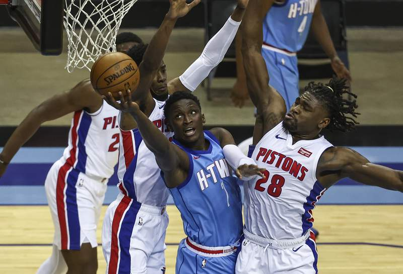Houston Rockets guard Victor Oladipo (7) shoots as Detroit Pistons center Isaiah Stewart (28) defends during the fourth quarter of an NBA basketball game Friday, March 19, 2021, in Houston. (Troy Taromina/Pool Photo via AP)