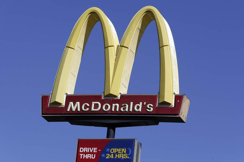 FILE - This Oct. 17, 2019 file photo shows a McDonald's sign along Interstate 40/85 in Burlington, N.C. McDonalds sales improved throughout the second quarter, Tuesday, July 28, 2020,  as markets reopened globally, but the fast food giant still faces a bumpy recovery. (AP Photo/Gerry Broome, File)