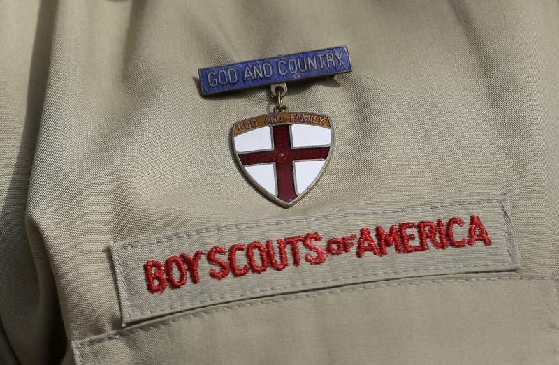 FILE - This Feb. 4, 2013 file photo shows a close up of a Boy Scout uniform in Irving, Texas. Amid the Boy Scouts of Americas complex bankruptcy case filed in February 2020, there is worsening friction between the BSA and the major religious groups that help it run thousands of Scout units. At issue: the churches fears that an eventual settlement  while protecting the BSA from future sex-abuse lawsuits  could leave many churches unprotected. (AP Photo/Tony Gutierrez, File)