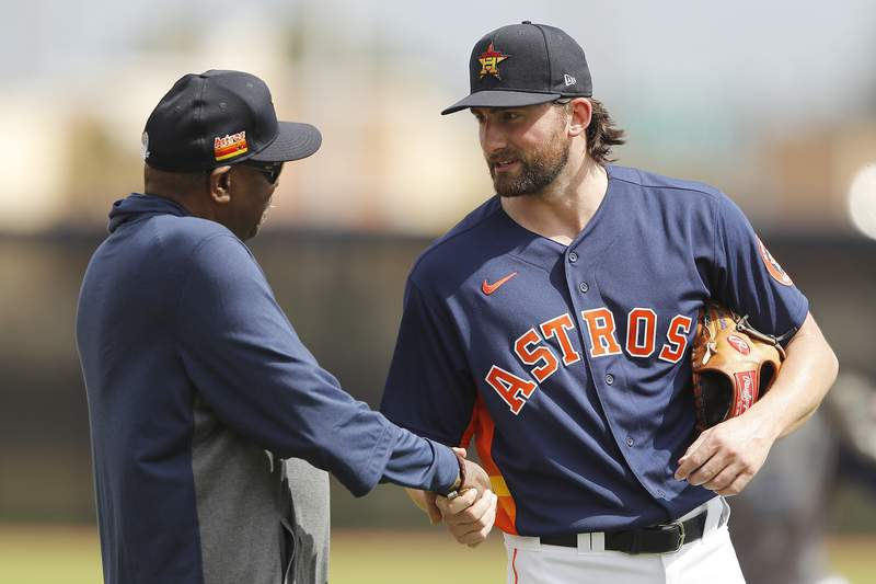 WEST PALM BEACH, FLORIDA - FEBRUARY 13:  Kent Emanuel #64 of the Houston Astros greets manager Dusty Baker during a team workout at FITTEAM Ballpark of The Palm Beaches on February 13, 2020 in West Palm Beach, Florida. (Photo by Michael Reaves/Getty Images)