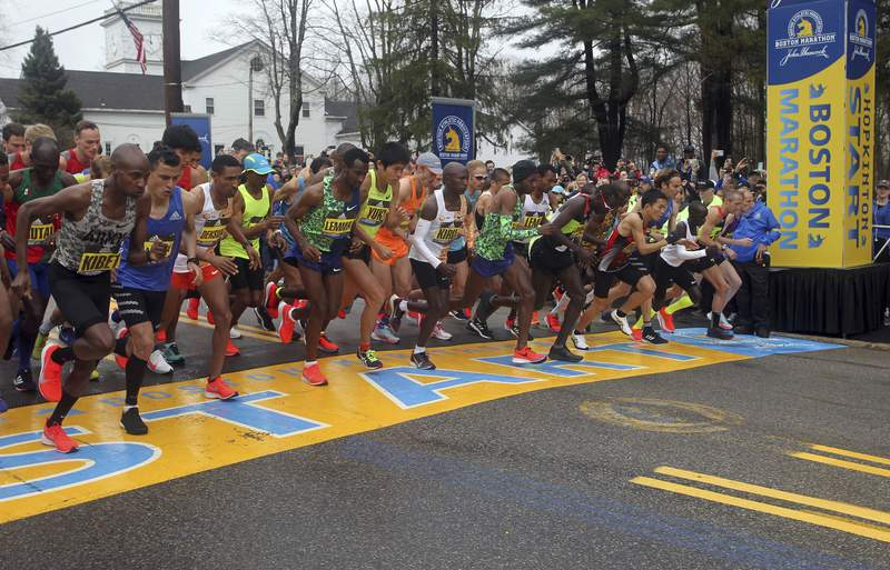 FILE - In this April 15, 2019, file photo, the elite men break from the start of the 123rd Boston Marathon in Hopkinton, Mass. The Boston Marathon is offering refunds for the first time because of the new coronavirus pandemic. Race organizers say anyone who was entered in the 124th edition of the race this month can still run on the rescheduled date, Sept. 14. But if they cant make it, they can have their money back. (AP Photo/Stew Milne, File)