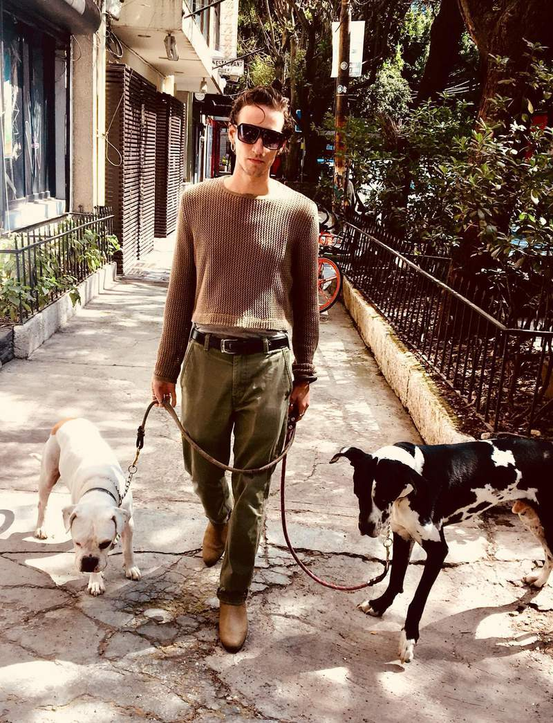 In this photo courtesy of Sophie Fustec shows her brother Pablo Fustec walking his dogs Sasha, right, and Felipe in Mexico City in Nov. of 2019. The dual citizen of France and Mexico died on July 5, 2020 after jumping into a scalding hot spring the previous month, on June 13, in a failed attempt to rescue Sasha. He had adopted the black and white Great Dane after finding it in a Mexico City street following the 2017 earthquake. (Sophie Fustec via AP)