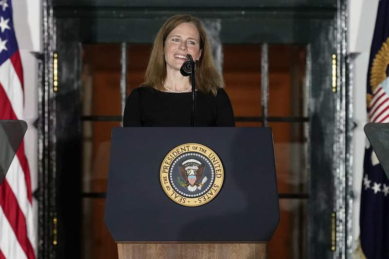 FILE - Amy Coney Barrett speaks on the South Lawn of the White House in Washington, Monday, Oct. 26, 2020.  Barrett has a book deal with a Penguin Random House imprint, The Associated Press has learned. Adrian Zackheim, who runs the conservative Sentinel imprint, confirmed Monday, April 19, 2021 that he has an agreement with Barrett, who last fall was approved by the Republican-led Senate to joint the court just weeks after the death of Justice Ruth Bader Ginsburg. (AP Photo/Alex Brandon, file)