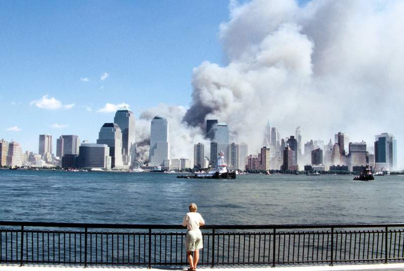 In this file photo, you see a view of the Manhattan skyline after a terrorist attack that destroyed the Twin Towers of the World Trade Center. A lone spectator watches the unfolding scene from a safe vantage point.