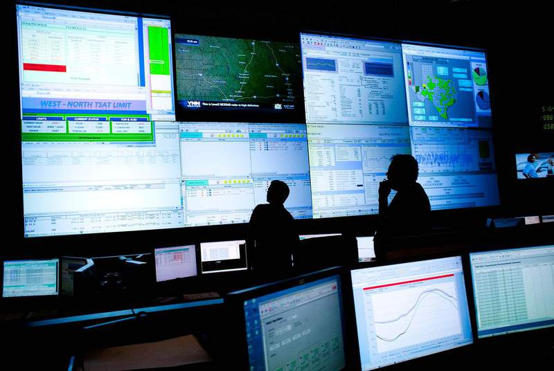 Reliability coordinators monitored the state power grid during a tour of the Electric Reliability Council of Texas command center in Taylor in 2012.  (Credit: REUTERS/Julia Robinson)