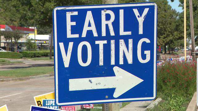 A sign directs voters to an early voting location in Houston on Nov. 2, 2018.