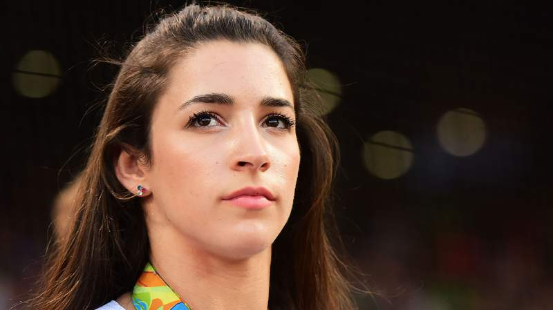 BOSTON, MA - AUGUST 26:  Olympic gymnast Aly Raisman looks on before throwing out a ceremonial first pitch before a game against the Kansas City Royals on August 26, 2016 at Fenway Park in Boston, Massachusetts.  (Photo by Adam Glanzman/Getty Images)