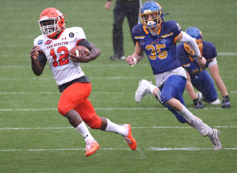 FRISCO, TEXAS - MAY 14: Jequez Ezzard #12 of the Sam Houston State Bearkats runs the ball against the South Dakota State Jackrabbits in the first quarter during the 2021 NCAA Division I Football Championship at Toyota Stadium on May 16, 2021 in Frisco, Texas. (Photo by Ronald Martinez/Getty Images)