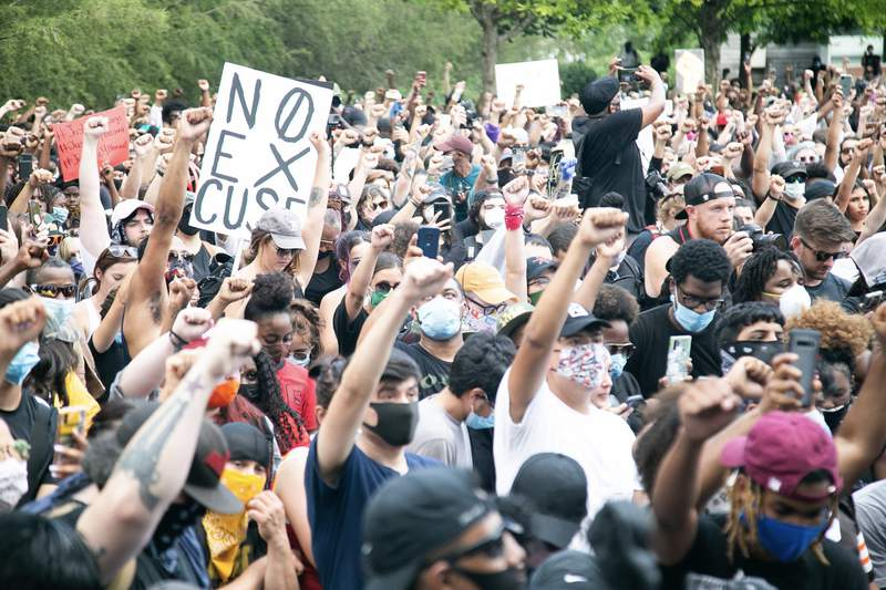 Houston photographer Adriana Byrum captured moving photos of demonstrators at march for George Floyd in Houston.