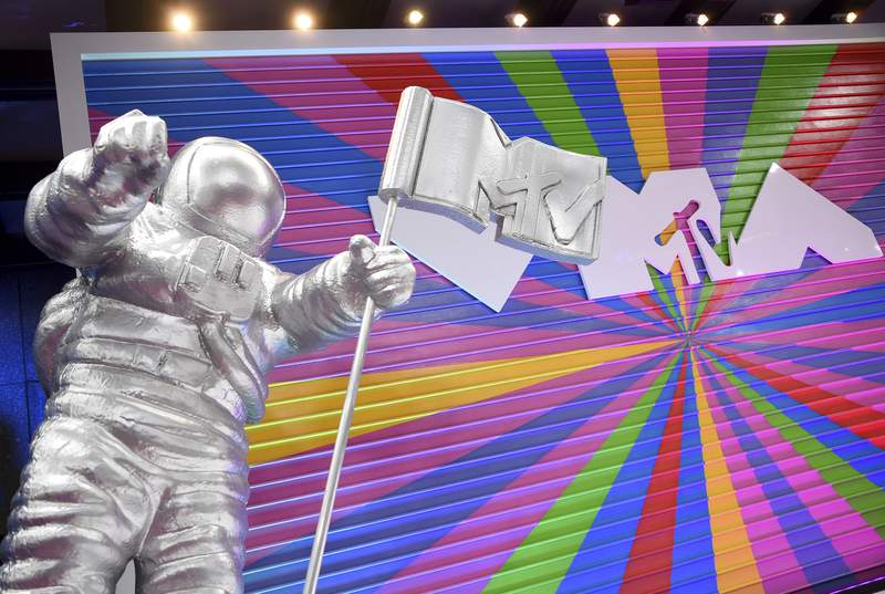 """In this Aug. 20, 2018, file photo, an MTV statue appears on the red carpet at the MTV Video Music Awards at Radio City Music Hall in New York. MTV is marking its 40th anniversary with a relaunch of its iconic image of an astronaut on the moon, with an MTV flag planted nearby. On Sunday, Aug. 1, 2021 the video channel unveiled a large scale Moon Person"""" during a ceremony at NASA's Kennedy Space Center in Cape Canaveral, Florida. (Photo by Evan Agostini/Invision/AP, File)"""