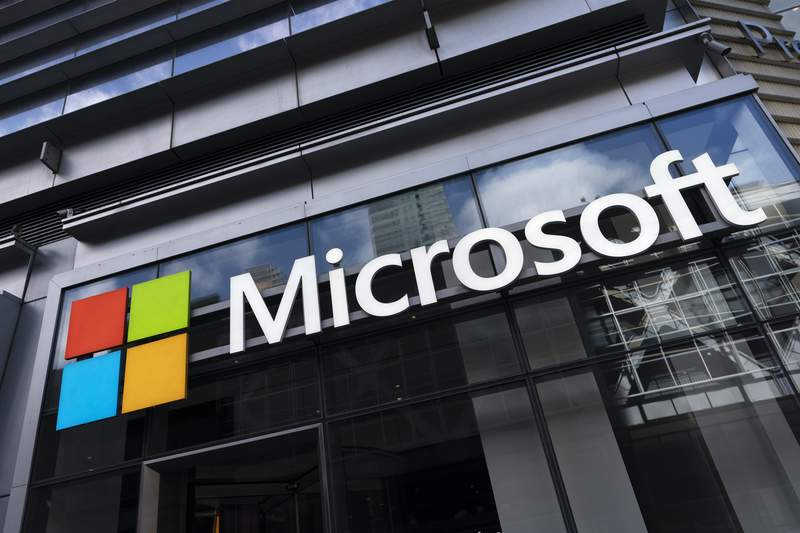 This May 6, 2021 photo shows a sign for Microsoft offices in New York.  Federal law enforcement agencies secretly seek the data of Microsoft customers thousands of times a year. That's according to congressional testimony being given Wednesday, June 30,  by a senior executive at the technology company. (AP Photo/Mark Lennihan)