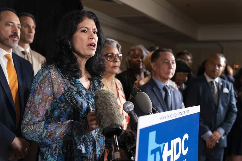 Democratic Texas State Sen. Carol Alvarado Houston, together with her fellow Texas legislators, speaks during a news conference, Wednesday, July 14, 2021, in Washington. (AP Photo/Manuel Balce Ceneta)