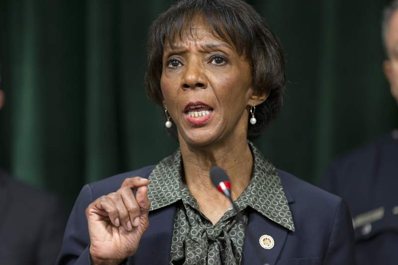 FILE - In this Jan.6, 2020 file photo Los Angeles County District Attorney Jackie Lacey talks during a news conference at the Hall of Justice in Los Angeles. Lacey's husband, David Lacey, on Tuesday, Aug. 4, 2020 was charged in an incident on March 2, 2020, in which he pointed a gun at Black Lives matter protesters outside the Lacey residence, as they demanded a meeting with her at her home the day before a primary election for her seat. (AP Photo/Damian Dovarganes, File)