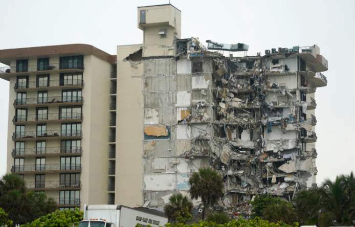 A view of a building is shown after a partial collapse, Thursday, June 24, 2021, in Surfside, Fla. A wing of a 12-story beachfront condo building collapsed with a roar in a town outside Miami early Thursday, trapping residents in rubble and twisted metal. (AP Photo/Wilfredo Lee)