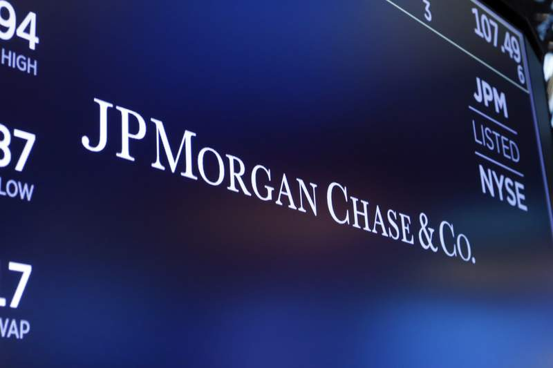 FILE - In this Aug. 16, 2019, file photo, the logo for JPMorgan Chase & Co. appears above a trading post on the floor of the New York Stock Exchange in New York. JPMorgan Chase will promote Marianne Lake and CFO Jennifer Piepszak to co-run the banks consumer finance division, potentially signaling that a woman may eventually run the nations biggest bank. Gordon Smith, who has run that division for several years, plans to retire at the end of the year.  (AP Photo/Richard Drew, File)
