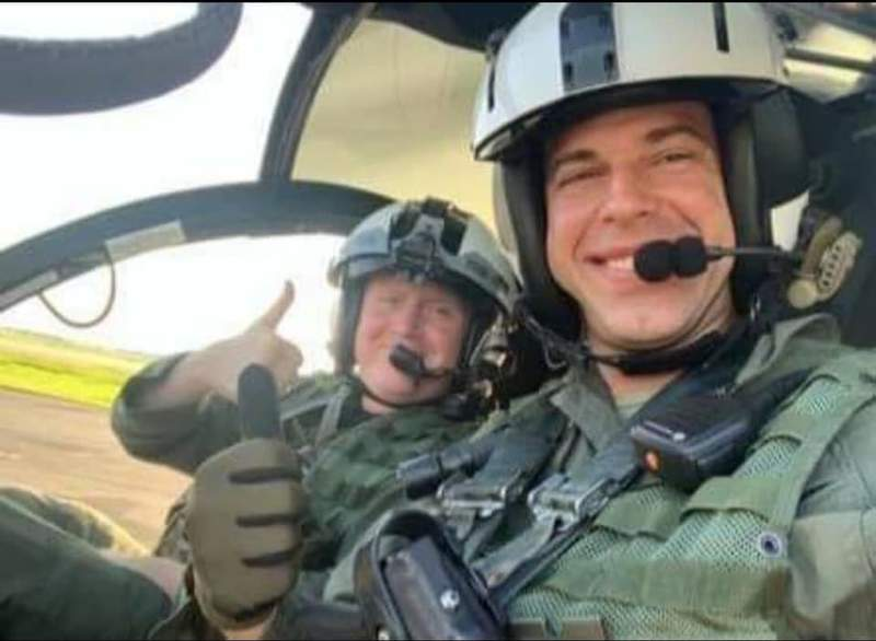 Jason Knox and Chase Cormier inside a helicopter.