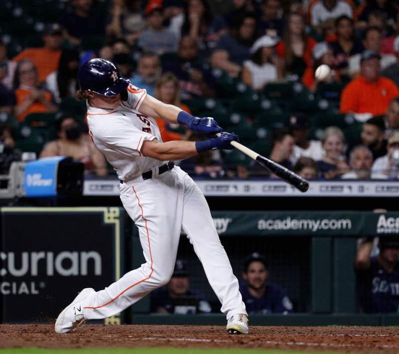 HOUSTON, TEXAS - SEPTEMBER 06: Jake Meyers #6 of the Houston Astros singles in a run in the fifth inning against the Seattle Mariners at Minute Maid Park on September 06, 2021 in Houston, Texas. (Photo by Bob Levey/Getty Images)