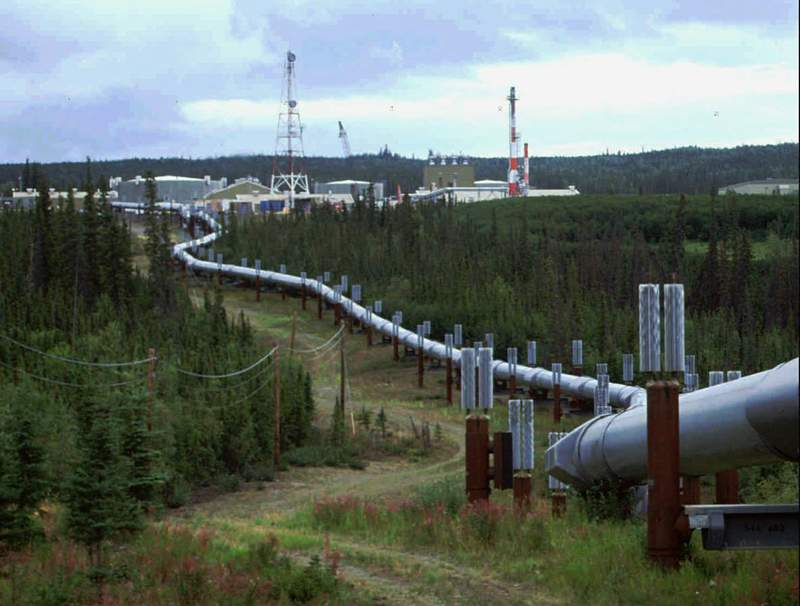 FILE - In this undated file photo the Trans-Alaska pipeline and pump station north of Fairbanks, Alaska is shown. The International Energy Agency says oil and gas companies aren't doing enough to reduce the release of methane, a potent source of planet-heating emissions, that is seeping out of pipelines and production plants. (AP Photo/Al Grillo, file)