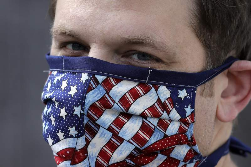 Drew Grande, 40, of Cranston, R.I., wears a protective mask over of concerns about the coronavirus outside his home, Wednesday, April 15, 2020, in Cranston. Grande began a log for contact tracing on his smartphone at the beginning of April, after he heard Rhode Island Gov. Gina Raimondo urge residents to start out of concern about the spread of the coronavirus. If Im going out to the store, Ill put the date, what store I went to, and then the time I was there, he said (AP Photo/Steven Senne)