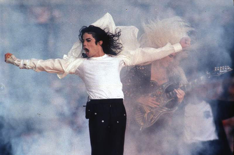 FILE - In this Feb. 1, 1993, file photo, Michael Jackson performs during the halftime show at the Super Bowl in Pasadena, Calif. A month-long Michael Jackson channel on SiriusXM satellite radio was announced Wednesday, July 15, 2020, by the singer's estate. The channel will feature music from Jackson's albums and from live performances, including his 1988 concerts at London's Wembley Stadium on his Bad Tour. (AP Photo/Rusty Kennedy, File)