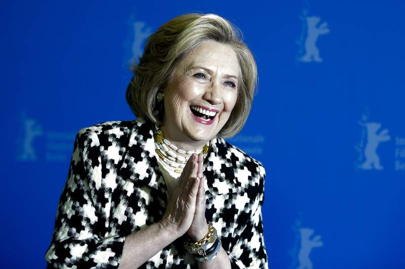 Former US Secretary of State, Hillary Clinton, poses for the photographers during a photo-call for the film 'Hillary' ' during the 70th International Film Festival Berlin, Berlinale in Berlin, Germany, Tuesday, Feb. 25, 2020. (AP Photo/Markus Schreiber)