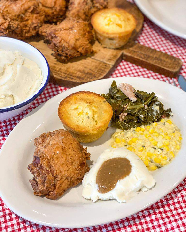 Goode Co.'s Goode Bird fried chicken with mashed potatoes, creamed corn and cornbread.